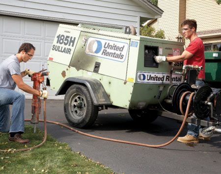 <b>Photo 2: The jackhammer option</b></br> A rented jackhammer powered by a big compressor is the best option for large or thick slabs. But a plain old sledgehammer is fine for most jobs.