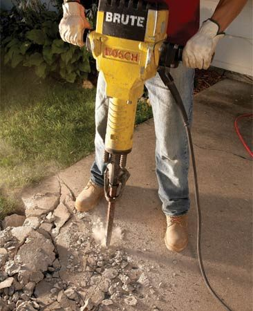 <b>Photo 1: Jackhammer technique</b></br> Take small bites with a jackhammer to crack the concrete. If you begin to drill a hole without creating a crack, STOP! Otherwise, you'll get the bit stuck in the concrete.
