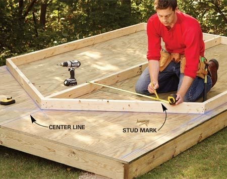 <b>Photo 1: Assemble the end walls</b></br> Build the end walls on the platform, using chalk lines as a guide. Start by nailing together the perimeter and adding the center stud. Then measure from the center stud to mark for the remaining studs.