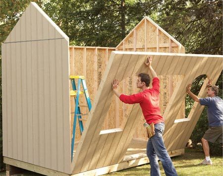<b>Photo 5: Nail the walls in place</b></br> Stand the walls, starting with the back wall. Then add the sides and finally the front. Nail each wall to the platform as you go and lock the corners together by nailing through the overhanging siding into studs.