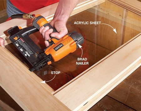 <b>Photo 9: Install wood stops to hold the Plexiglas in place</b></br> Set the plywood and Plexiglas insert into the recessed area on the back of the door. Nail wood stops around the perimeter to hold them in place.