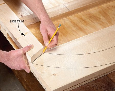 <b>Photo 13: Mark the angled cuts on the side trim pieces</b></br> Mark and cut the side trim pieces. Then set them in place on the top piece to mark the angled cuts.