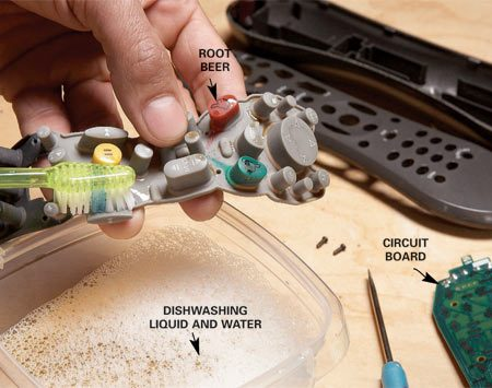 <b>Photo 1: Remove and scrub the buttons</b><br/>Remove the buttons from the circuit board and scrub off any sticky stuff with water and dishwashing liquid.