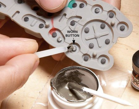 <b>Photo 2: Paint the buttons</b><br/>Repaint each button with a new coat of conductive paint. Let it cure for 72 hours before reassembling.
