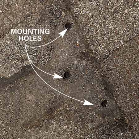 <b>Photo 1: Small hole problem</b></br> Leftover mounting holes can let in vast amounts of water.