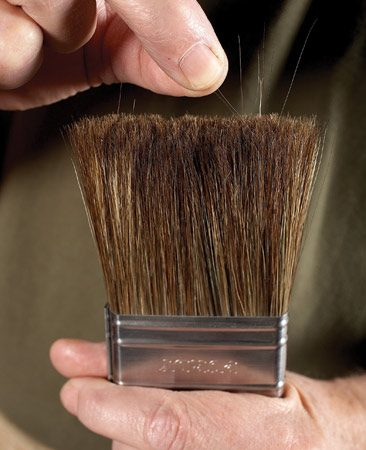 "<b>Pluck problems out</b></br> ""Loose bristles coming out of the brush and drying on your project are a headache you can prevent,"" Dave said. Just smack a clean, dry brush several times against the palm of your hand. Loose bristles stick out from the end of the brush and are easily plucked before you dip the brush in the can."