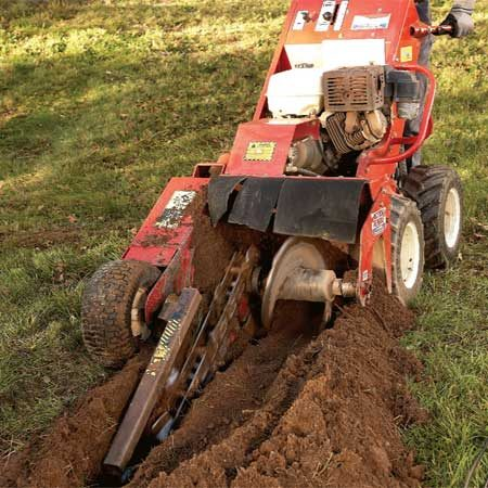 <b>Power trencher in action</b></br> A power trencher digs deep trenches quickly. But it may not work well in rocky or root-filled areas.