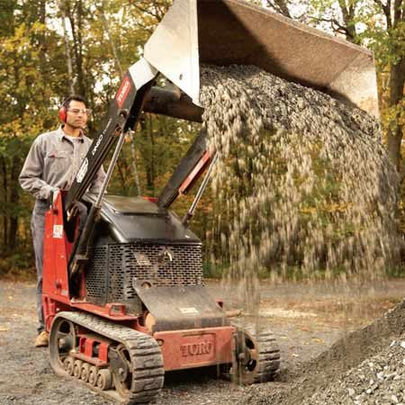 <b>Loader in action</b></br> A power loader saves you tons of wheelbarrow loading and dumping.
