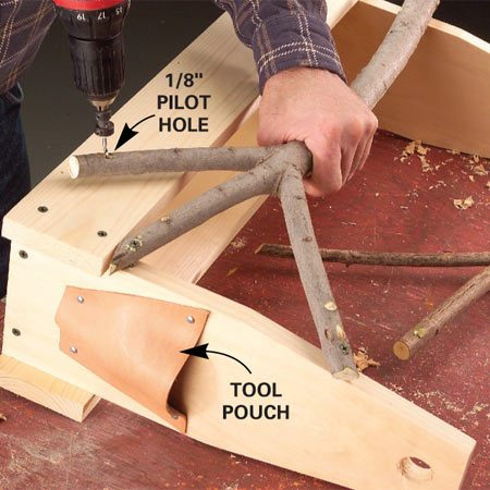 <b>Photo 2: Fit the branches</b></br> Cut the branch ends to fit. Attach the pieces to the sides of the toolbox with screws or nails. Predrill to avoid splitting.