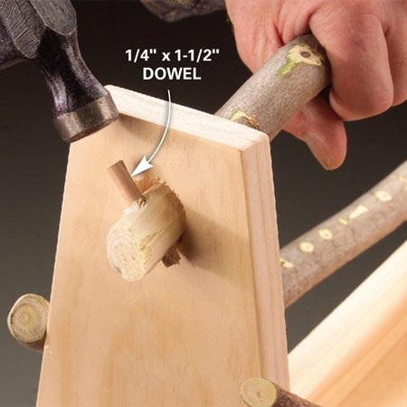 <b>Photo 3: Tap in dowels</b></br> Drill 1/4-in. holes through the handle ends and drive in the dowels to hold the handle in place.