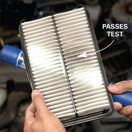 <b>Photo 2: Check the air filter</b></br> Hold the filter in front of a shop light. If dirt blocks more than 50 percent of the light, replace the filter.