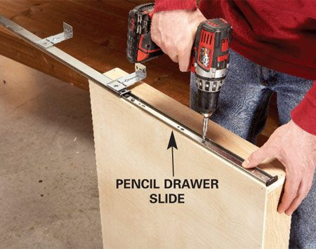 "<b>Photo 1: Install special pencil drawer slides</b></br> Mount the drawers with special ""pencil drawer"" slides. These slides include hanger brackets, so you don't have to build extra parts just to attach drawer slides."