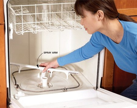 <b>Photo 1: Clean the spray arm</b></br> Remove the spray arm and clean out the holes. This also allows access to the filter for cleaning. Spray arms like the one we show simply snap off. Others require you to unscrew a cap on top.