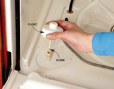 <b>Photo 3: Clean the float</b></br> Make sure the float moves up and down freely. If the float on your dishwasher is removable, take the float apart and clean it.