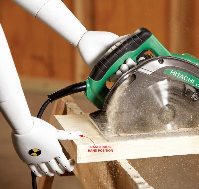 Nigel cutting with a circular saw