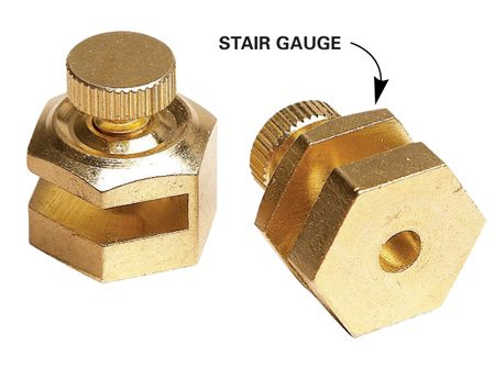<b>Close-up of stair gauges </b></br> Stair gauges are designed to clamp to the edge of a framing square.