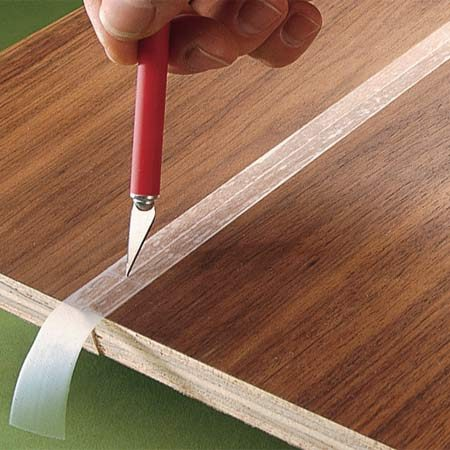 <b>Tape edges before gluing</b><br/>Apply masking tape over the joint and then cut it so that the edge of each board is protected from excess glue.