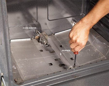 <b>Photo 1: Remove the burner</b></br> Remove the old igniter from the burner. Unscrew the burner if necessary. Cut or unplug the wires.