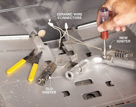 <b>Photo 2: Install the new igniter</b></br> Reconnect the wires and attach the new igniter to the burner. Reinstall the burner and push the wire connectors and excess wire down into the compartment below the oven.