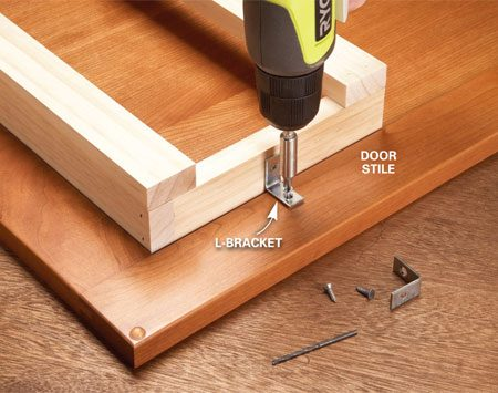 <b>Photo 2: Mount the rack</b></br> Mount the rack on the door with L-brackets. This is easiest if you remove the door. Be sure to predrill screw holes in the door stiles.