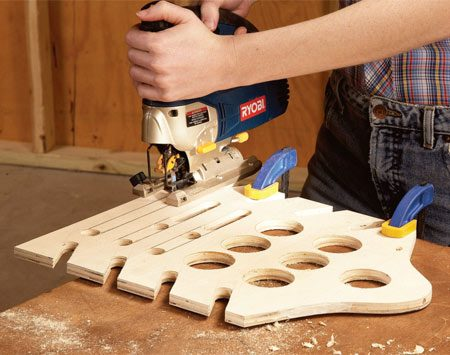 <b>Photo 2: Cut slots</b></br> Use a 5/8-in. Forstner drill bit or a sharp spade bit to punch out the ends of the slots, and then finish cutting them out with a jigsaw.