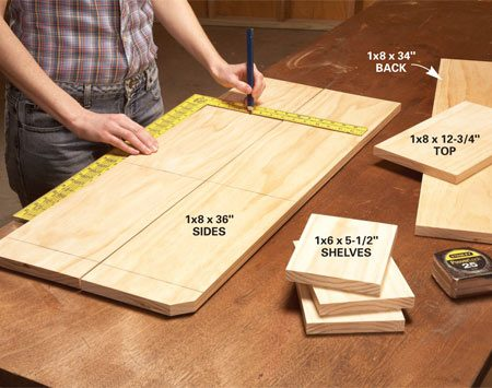 <b>Photo 1: Mark the shelf positions</b></br> Place the sides next to each other and mark the shelf positions. For easier finishing, sand all the parts before marking and assembly.