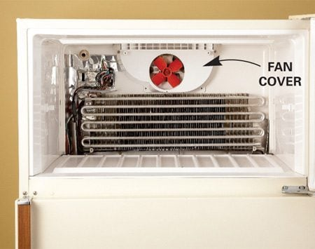<b>Photo 2: Remove fan cover</b></br> If your refrigerator has a fan cover, remove the screws that hold it in place. Then remove the cover to reach the fan.