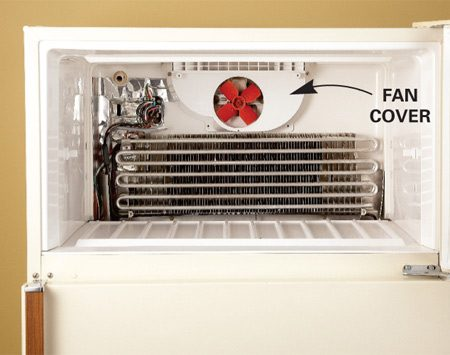 <b>Photo 2: Remove fan cover</b><br/>If your refrigerator has a fan cover, remove the screws that hold it in place. Then remove the cover to reach the fan.