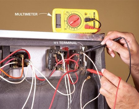 <b>Photo 3: Test the switch</b></br> Test the switch. Unplug the range and turn on the burner. Remove the wire from the H1 terminal. Set the tester to RX-1 and place the probes on the H1 and H2 terminals. Replace the switch if the tester reading doesn't change.
