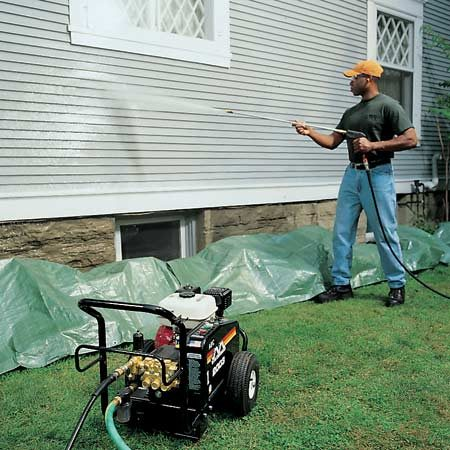 <b>Pressure wash outdoor areas</b></br> Use a pressure washer to clean siding to save a ton of time when preparing to paint.