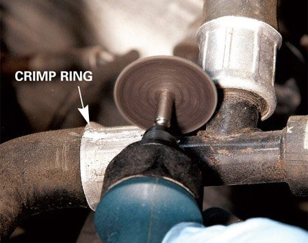 <b>Photo 1: Cut the crimp ring</b></br> Cut through the crimp ring with a rotary tool and cutoff wheel or a close-quarters hacksaw.