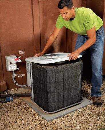 <b>Photo 1: Open the unit</b></br> Unscrew and lift off the top panel. The heavy fan motor is mounted on the panel, so have a helper hold it while you install the blanket.