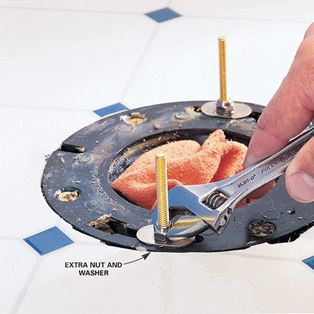 <b>Toilet-setting solution</b></br> Setting a toilet onto the new bolts can be the most frustrating part of the whole installation. The bolts slip and tip as you're straining to align them with the holes in the toilet. And each time you miss, you risk crushing or shifting the wax ring. The plastic slip-on washers sometimes included with bolts help, but they still allow the bolts to move. The best approach is to buy a second set of nuts and washers so you can lock the bolts in place before you set the toilet. To make sure they're in the correct position, set the toilet and check its height and position. Then lift it off and add the wax ring. To make the bolts easier to find, mark their locations with masking tape.