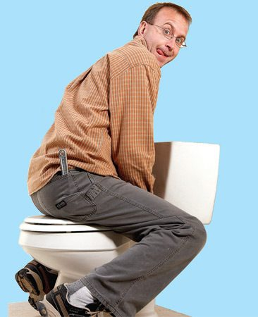 "<b>""Seat"" the toilet firmly</b></br> When you set the toilet in place, you have to squish the wax ring until the toilet settles to the floor. DON'T force the toilet down by tightening the nuts on the toilet bolts—that might crack the porcelain base. Instead, sit on the toilet backward with your weight centered over the wax ring. Then wiggle around a bit until the toilet reaches the floor. But don't go crazy. You want to drive the toilet straight down with minimal twisting or shifting of it from side to side. When the toilet reaches the floor, snug down the toilet bolt nuts."
