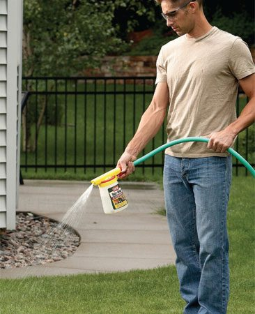 <b>Photo 8: Spray the lawn</b><br/>Spray a lawn and garden insect killer on the grass within one day of mowing. Also spray on trees and shrubs. Spray on a calm day to prevent drift.