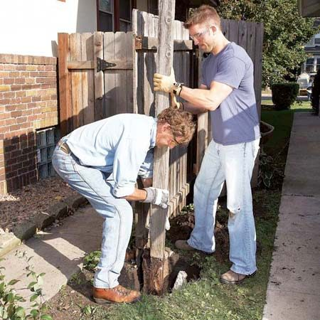<b>Removing the post</b></br> Yank the fence post out of the ground after you've broken off enough concrete to lighten the load.