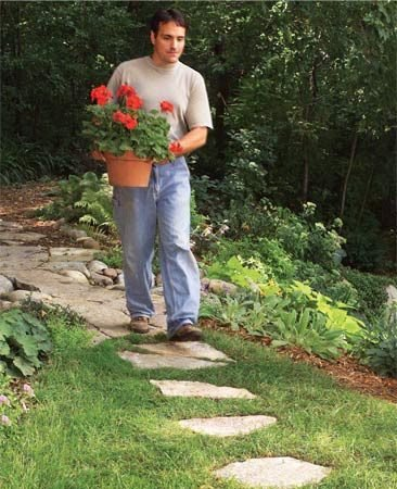 <b>Stepping-stones</b></br> Stepping-stone paths are inexpensive and easy to make—simply set them into the grass.
