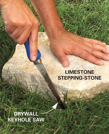 <b>Trace the stone</b></br> Place the flagstone where you want it, then cut the outline in the grass.