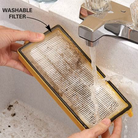 <b>Photo 2: Replace or clean</b></br> Use gentle water pressure from a sprayer or faucet to clean both sides of the filter.