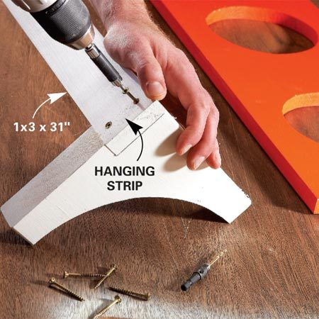 <b>Photo 3: Hanging strip</b><br/>Predrill and screw the hanging strip to the brackets. Then center and screw the shelf to the brackets and to the hanging strip.