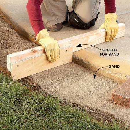 <b>Photo 4: Screed the sand</b></br> Add a layer of sand on top of the gravel to create a flat bed for the brick. Bricks should protrude about 1/2 in. above the sidewalk when set on the screeded sand.