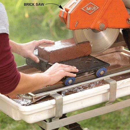 <b>Photo 7: Cut the bricks</b></br> Rent a brick saw if you have a lot of bricks to cut. Water spraying on the diamond blade keeps dust to a minimum and speeds cutting.