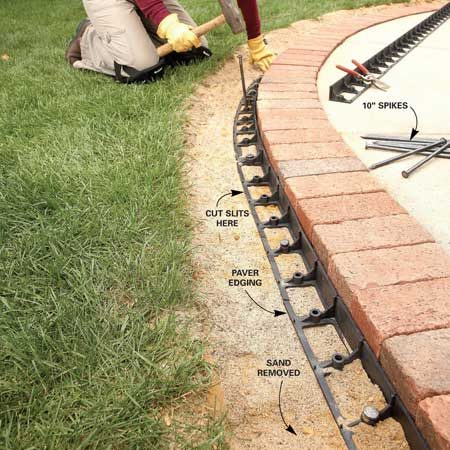 <b>Photo 8: Nail the edging</b></br> Hold the bricks securely in place with plastic paver edging. Press the plastic edging against the bricks and secure it with spikes. The edging bends easily once you cut the plastic band along the outside edge.