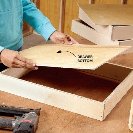 <b>Photo 2: Build the boxes</b></br> Build super-simple drawer boxes. Just glue and nail the sides, front and back together, then glue and nail on the plywood bottom.