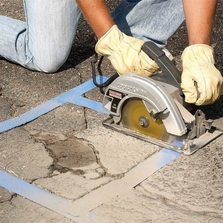 <b>Photo 4: Saw out cracked areas</b></br> Saw around heavily cracked areas using a circular saw and diamond blade. Chisel out all the loose asphalt down to the gravel base.