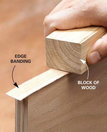 <b>Press with a block</b></br> Use a wood block to press the hot veneer so the glue bonds tightly.