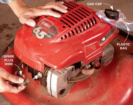 <b>Photo 1: Safety precautions before starting</b></br> Pull the wire from the spark plug. Remove the gas cap, put a piece of plastic over the opening and replace the cap. This will help prevent gas spills when you flip the mower to access the blade.