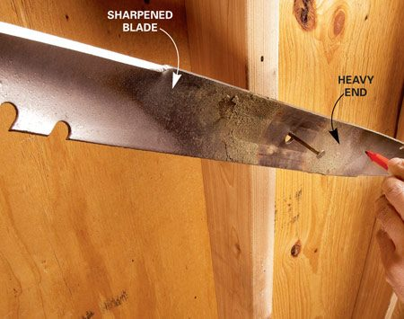 <b>Photo 4: Balance the blade</b></br> <p>Balance the  blade on a nail after you've sharpened both edges. If one side is heavy,   it'll drop. Mark  the heavy side so you'll know which end to grind. Grind a little off the   heavy side and  hang the blade on the nail again to recheck it. Repeat this process until   the blade hangs level. </p>