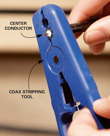 <b>Photo 2: Strip the cable</b></br> Prepare the end of the cable for installation of the new F-connector with a special coax cable stripper. This is a two-step process with this style stripper.