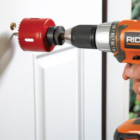 <b>In-door viewer installation</b></br> Chuck up a 2-3/8-in. hole saw and cut a large opening for a new door viewer. Screw it in place and see who's at the door from 7 ft. away.